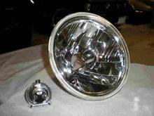 """1)Lightandbulb1  I got the headlights like those in the link below (7"""" tribar conversion w/ H4 bulbs) but there are other types you can get as well.    http://cgi.ebay.com/ebaymotors/7-STREET-ROD-TRIBAR-HEADLIGHTS-1952-53-55-56-57-CHEVY_W0QQcmdZViewItemQQ_trksidZp3286Q2em20Q2el1116QQhashZitem4832b44868QQitemZ310088321128QQptZMotorsQ5fCarQ5fTruckQ5fPartsQ5fAccessories"""