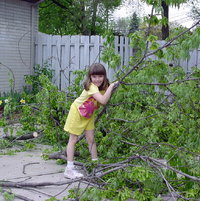 May-2003. Granddaughter posing with branches.