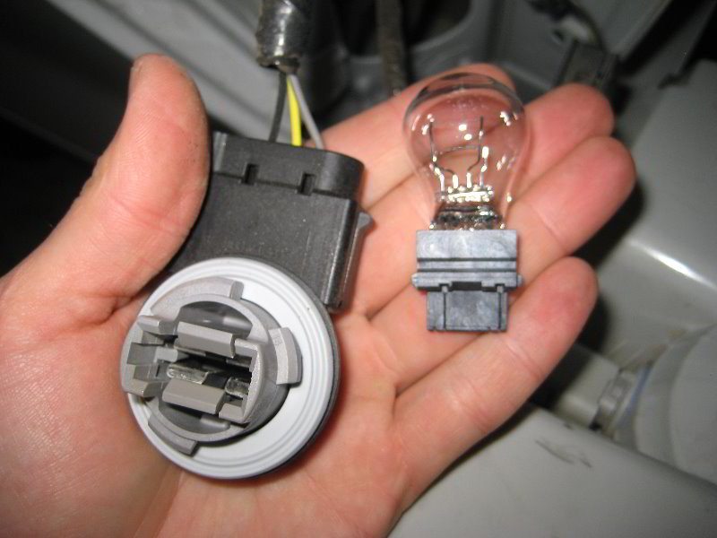 ford f150 f250 install tail light bulb how to ford trucks  step 3 install the new bulb