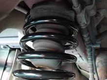 Passenger Side Helper Spring; close to parking brake cables