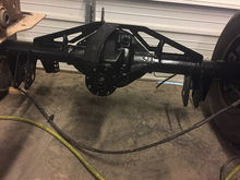8.8 rear with everything welded up (still got to close up the back of the top 3-link mount), sanded, and extreme chassis black painted.