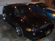 Here's the car in storage for the winter just after purchase with my brothers '94 GT convertible.