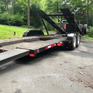 Compact open 2 car hauler with hydraulic lift
