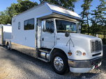 Freightliner FL112 totter with a Renegade box  for sale $80,000