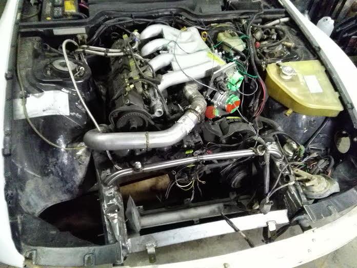 engine_bay_ddfcab1e0751ed1059aab3ef3354129723ab9c6f.jpg