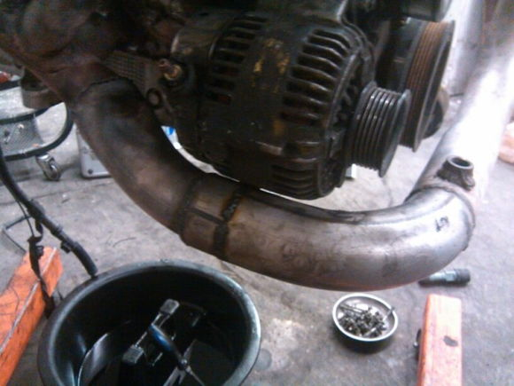 The alternator clearence, this is how close it has to sit to clear the frame and components and had to move thepwr steering line on gear box