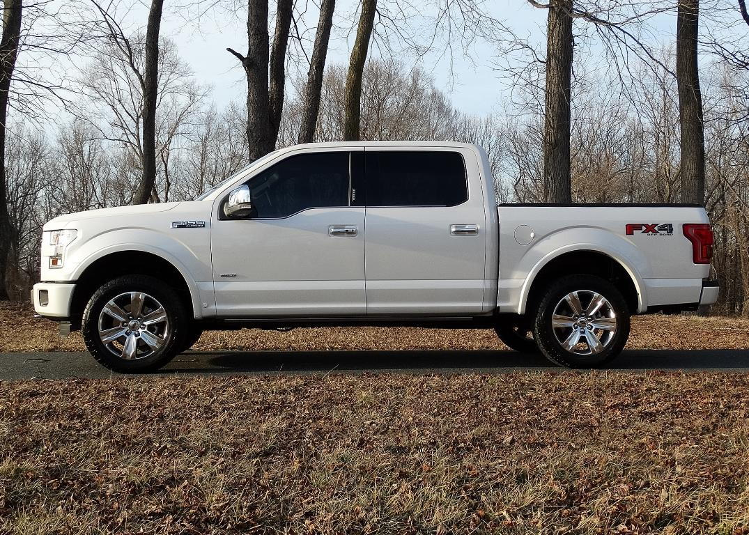 Any pics of 2015 f150 4x4 with level and stock tires