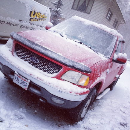 "my truck after the 11"" of snow"