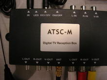 TV tuner comes with antenna and hand remote control.