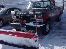 The plow truck, with a 90s bumper, roll bar, and 351