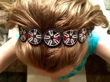 """18"""" Cup Spoke JCW wheels, designed into a free-standing lace embroidery and constructed into a headband."""