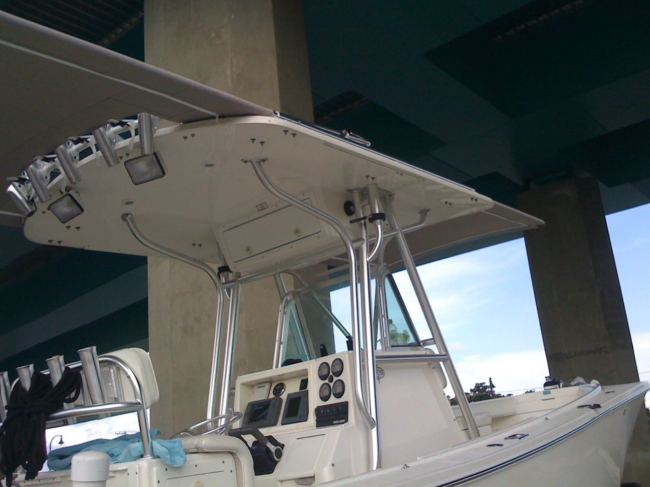 Anyone make a sun shade using existing outriggers? - The Hull Truth