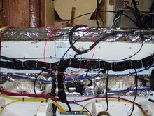 Regulator mounted to bulk head between engines