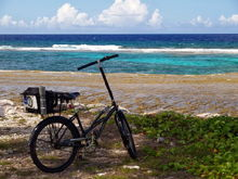 My custom 300.00 china built sun three speed , elevated handle bars for easy atoll cycling with a poncho on during rainy season.  three years tops,   out here on any bike.