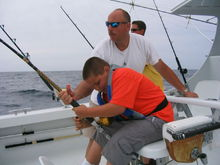My son and I bringing in the tuna in the Outer Banks