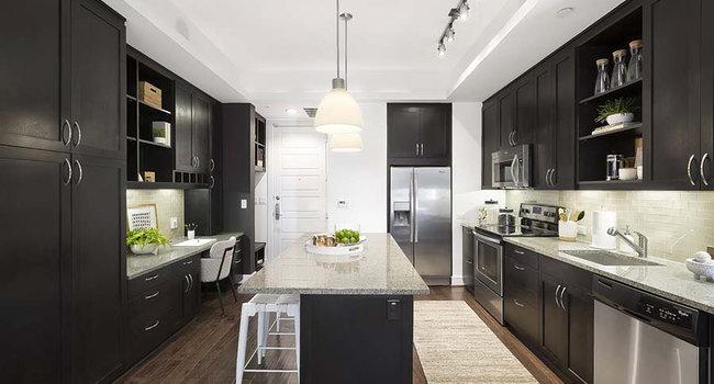 Beautiful open kitchen. Custom kitchen Cabinets, designer tile backsplash Stainless steel appliance package, Premium granite counter tops.